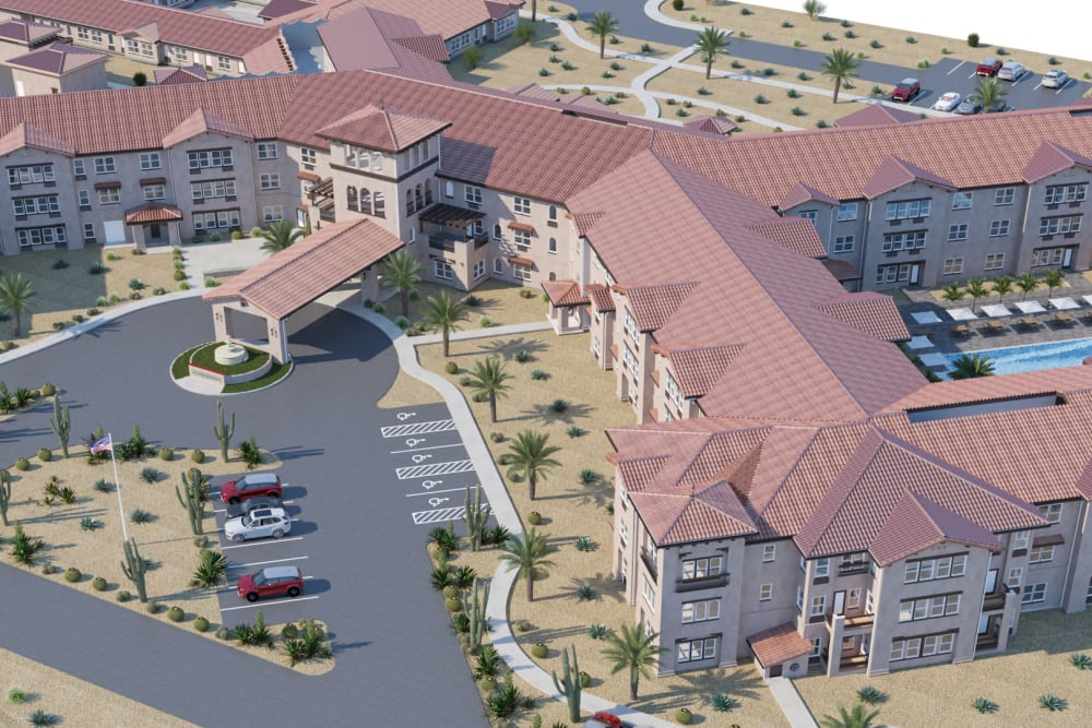 Building with white washed exterior, tile roofing and desert plant vegetation at Ativo Senior Living of Sundance in Buckeye, Arizona