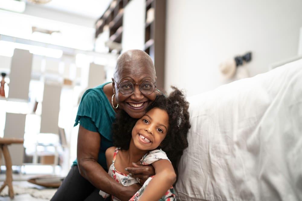 A grandmother and granddaughter embrace at Broadwell Senior Living in Kearney, Nebraska