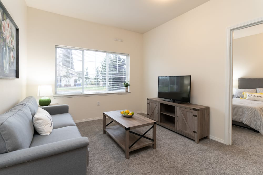 Apartment TV and bedroom at King's Manor Senior Living Community