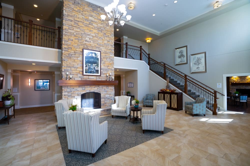 Elegant reception areas with seating and a fireplace available at Ebenezer Senior Living properties