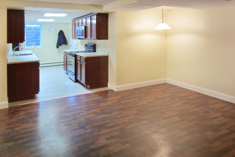 Kitchen and living room area with nice wood style flooring at Eagle Rock Apartments at West Hartford in West Hartford, Connecticut