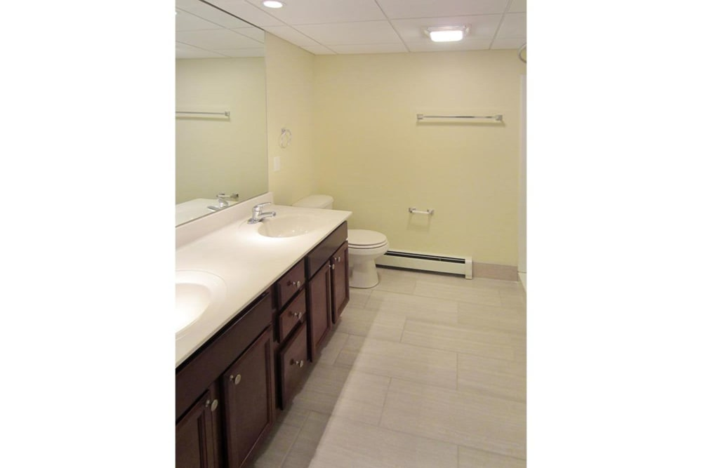 Clean bathroom with tons of counterspace and tile style flooring at Eagle Rock Apartments at West Hartford in West Hartford, Connecticut