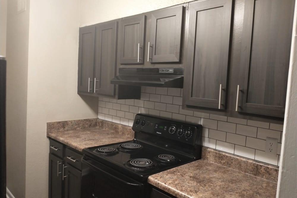 Black stove with white subway tile backsplash at The Village at Crestview in Madison, Tennessee