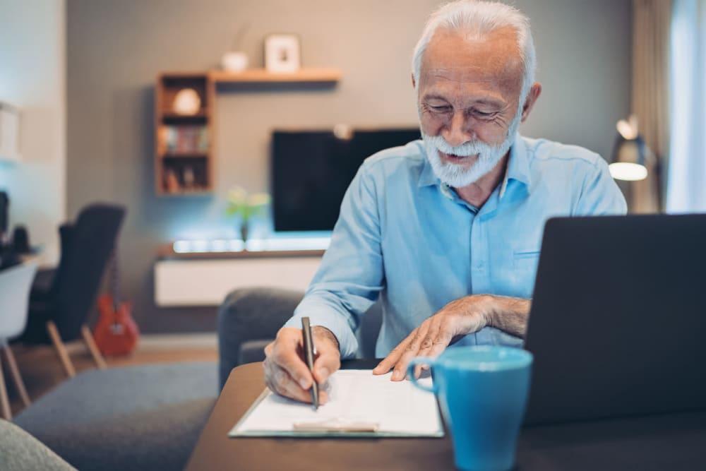 Resident working at his desk at York Gardens in Edina, Minnesota
