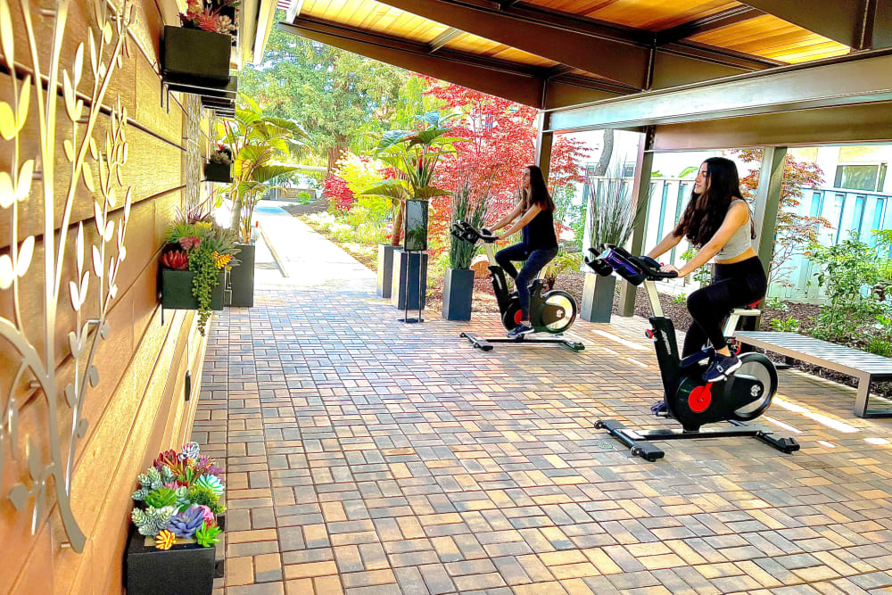 Resident working on at Newport Apartments' fitness center in Campbell, California