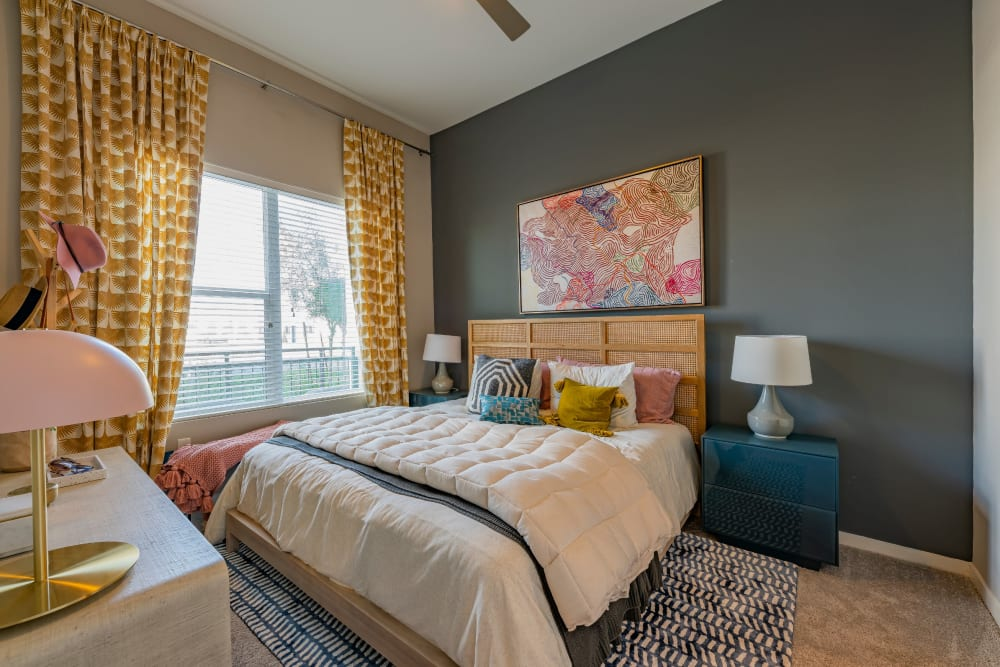 A master bedroom with a large window at Encore Tessera in Phoenix, Arizona