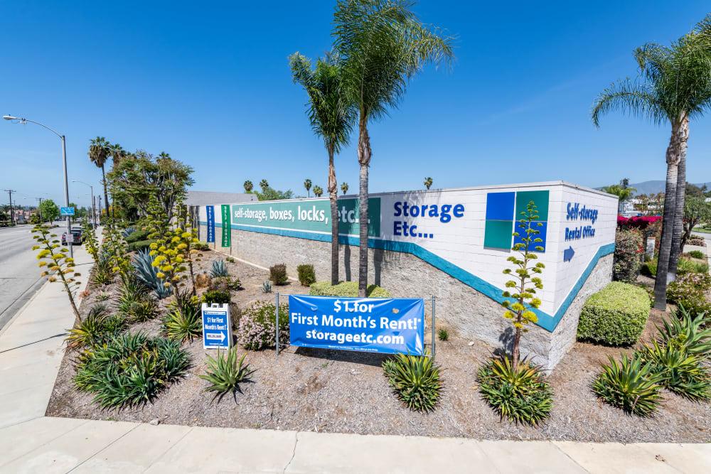 Storage Etc... Pomona sign outside near palm trees