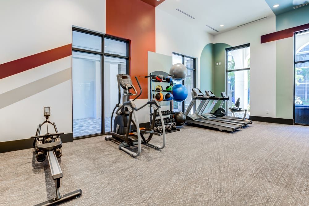 Fitness Center with cardio equipment and weights at Solera at City Centre in Palm Beach Gardens, Florida