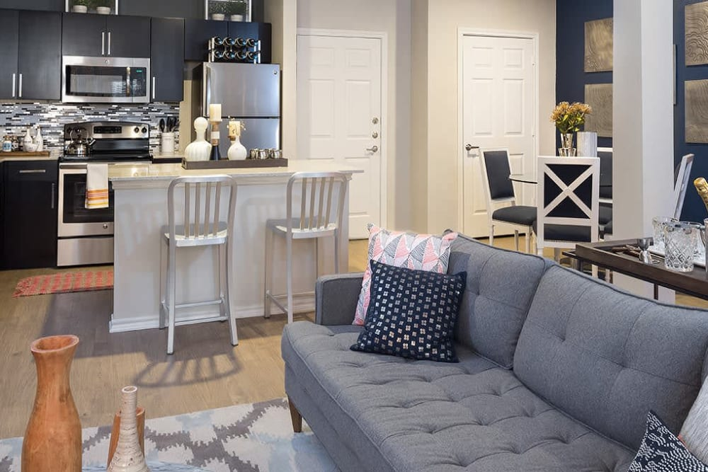 Living room and kitchen at Alesio Urban Center in Irving, Texas