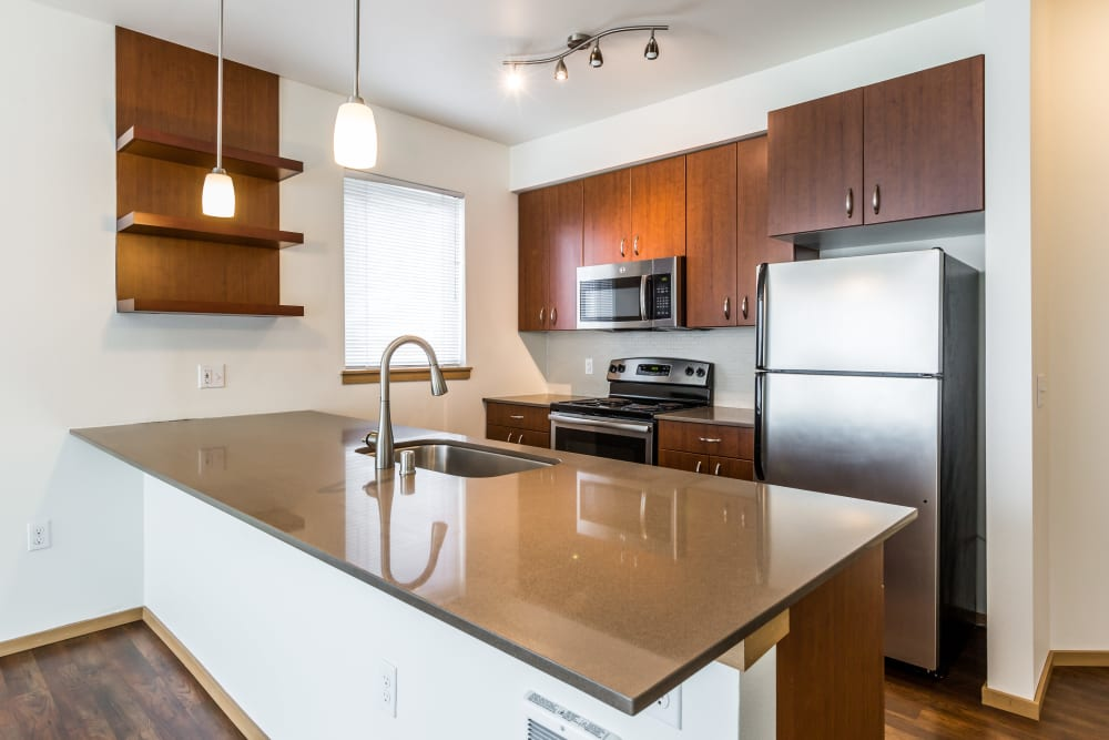 Kitchen with granite counters at Marq West Seattle in Seattle, Washington