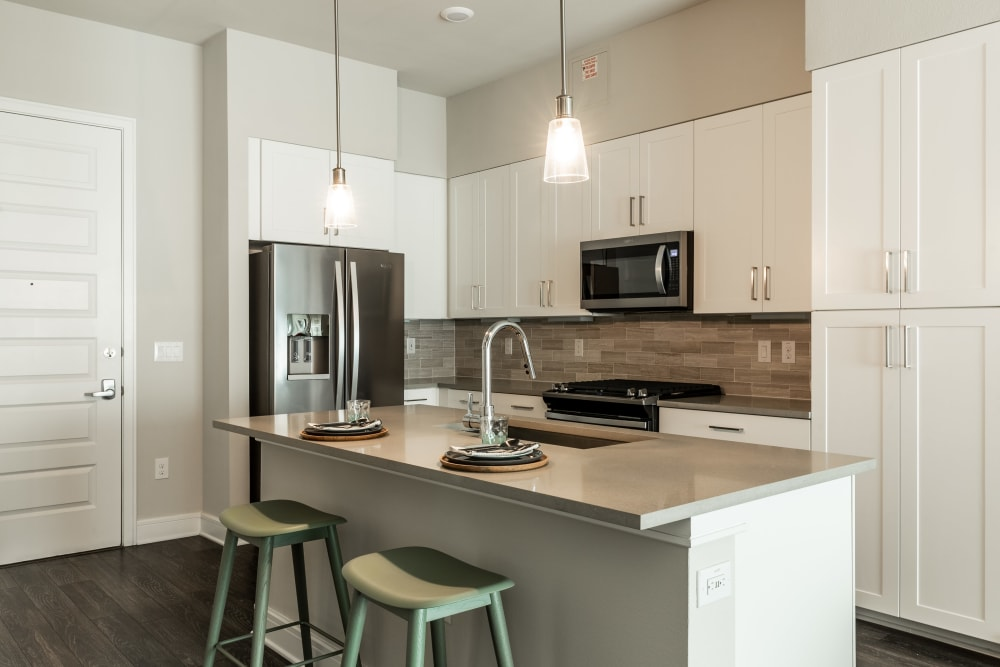 Kitchen with stainless steel appliances at The Clark in Austin, Texas