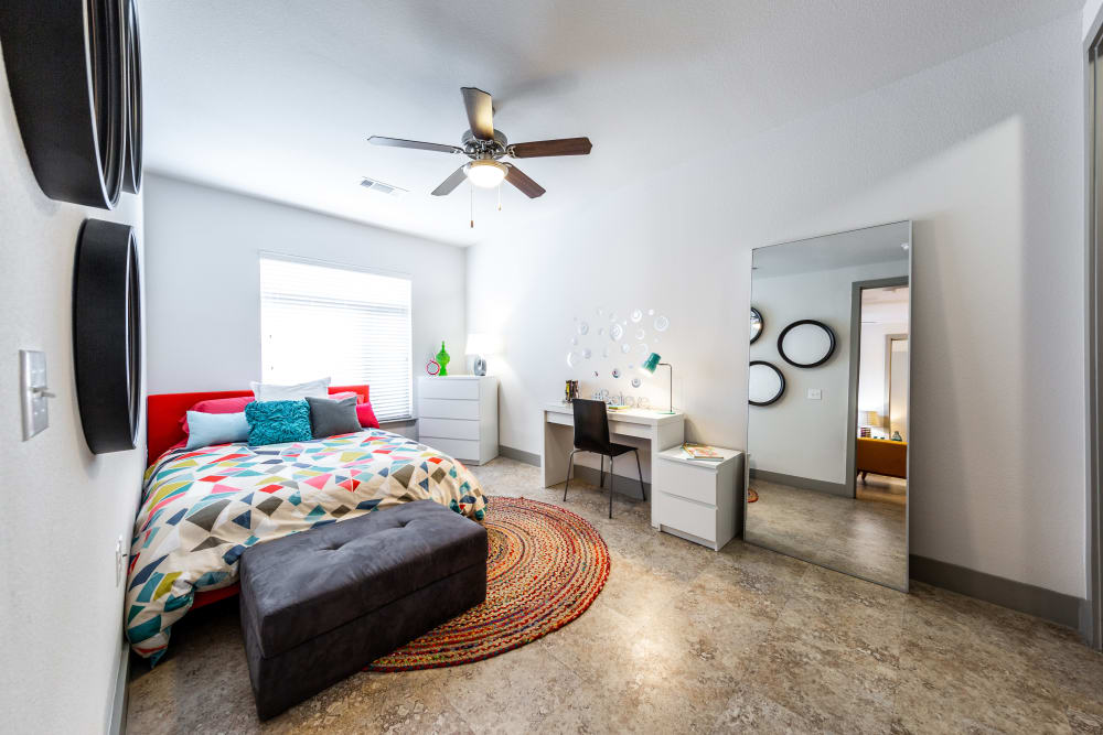Bedroom with a ceiling fan at Regents West at 24th in Austin, Texas