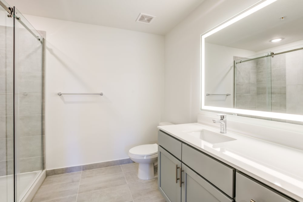 Standing shower in oversized bathroom at Solera at City Centre in Palm Beach Gardens, Florida