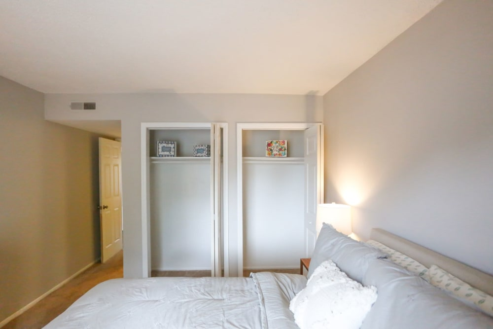 Bedroom with tons of closet space ready for move in at The Flats at Arrowood in Charlotte, North Carolina