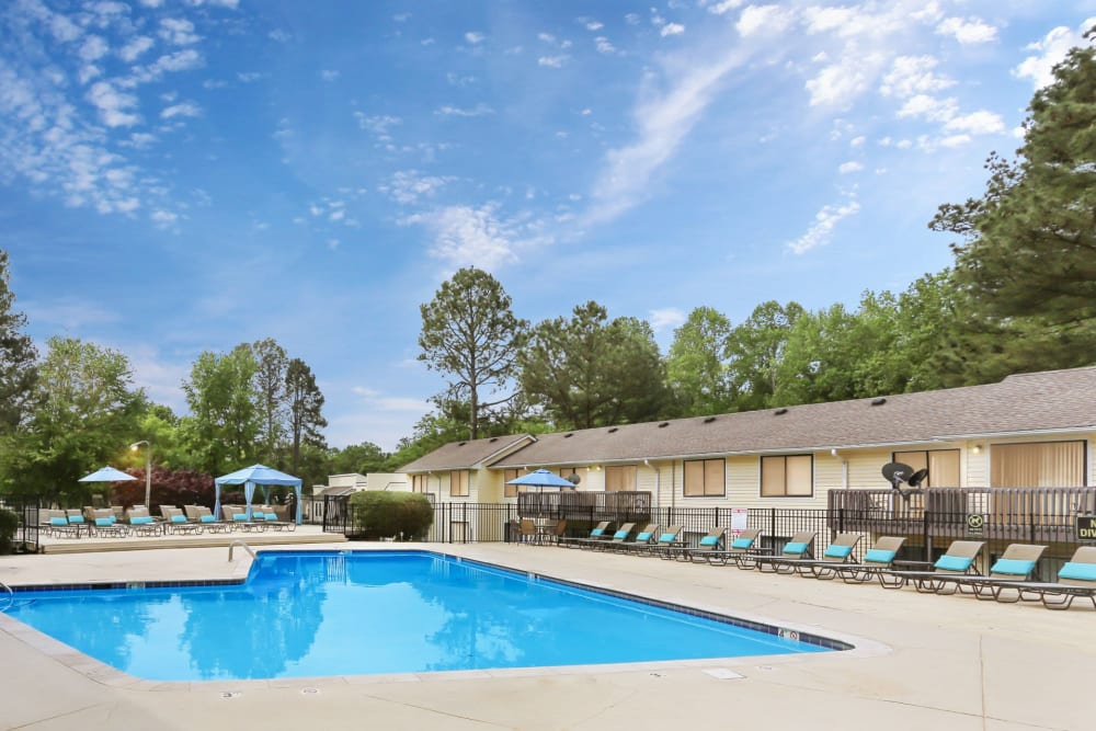 Resort style swimming pool with ample lounge chairs for everyone at The Flats at Arrowood in Charlotte, North Carolina