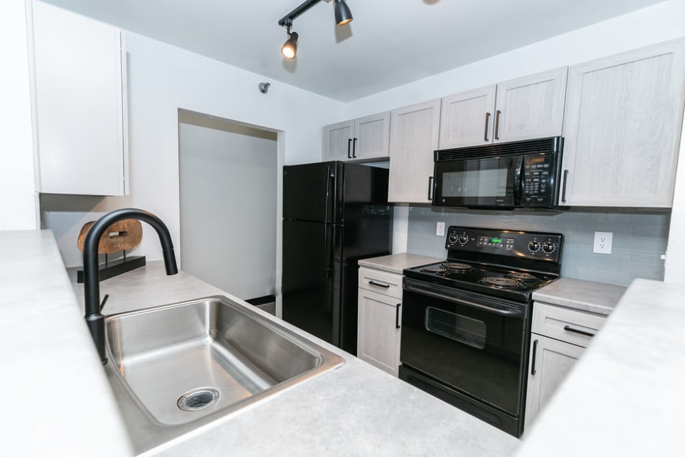 Kitchen with stainless steel appliances at Lofts at Riverwalk in Columbus, Georgia