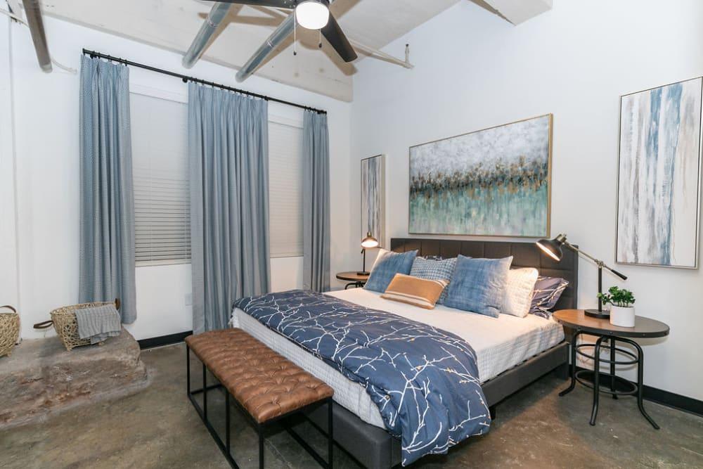 Well decorated bedroom at Lofts at Riverwalk in Columbus, Georgia