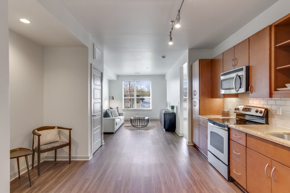 Model kitchen and living area at 12 South Apartments in Nashville, Tennessee
