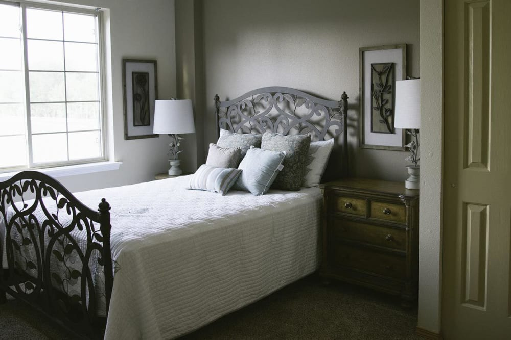 Upscale bedroom in senior living apartment at The Springs at Whitefish in Whitefish, Montana