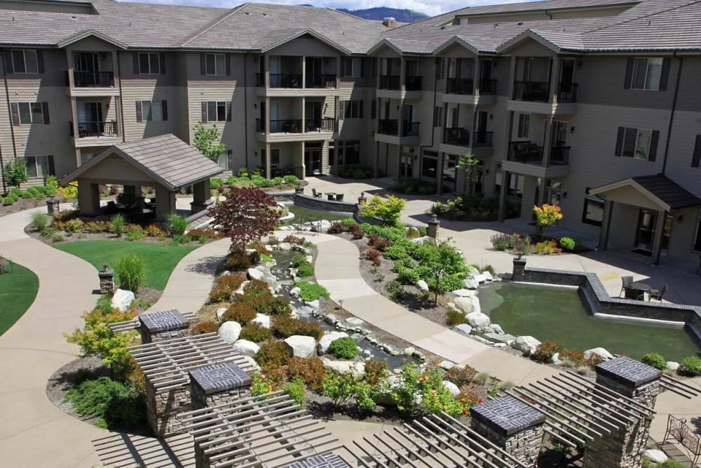 Idyllic courtyard with foliage and pond at The Springs at Veranda Park in Medford, Oregon