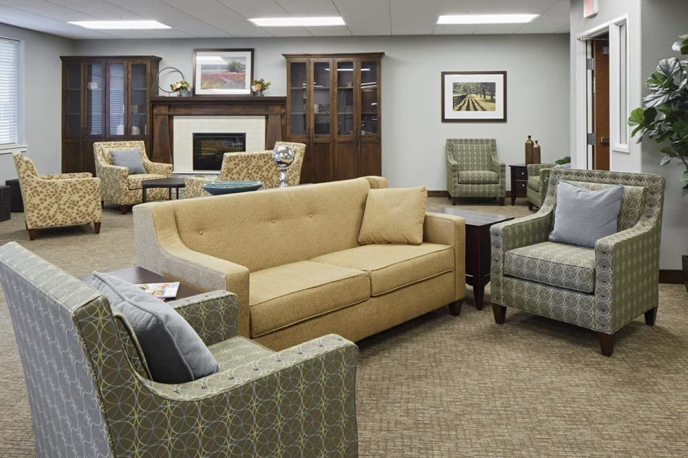 Spacious upscale living room with fireplace at The Springs at Veranda Park in Medford, Oregon
