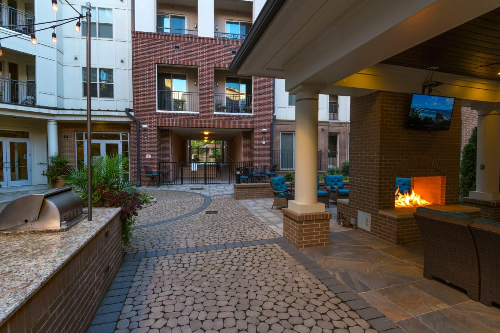Courtyard patio with fireplace at 401 Oberlin in Raleigh, North Carolina