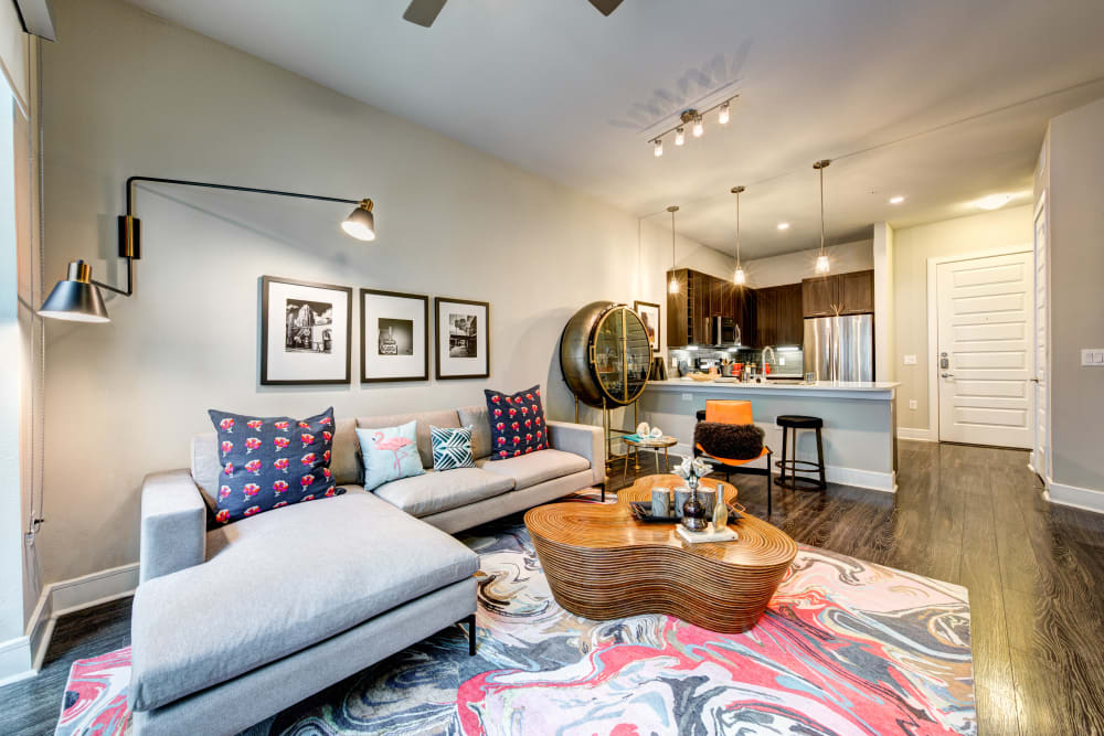Living room with wood style flooring at Water Marq in Austin, Texas