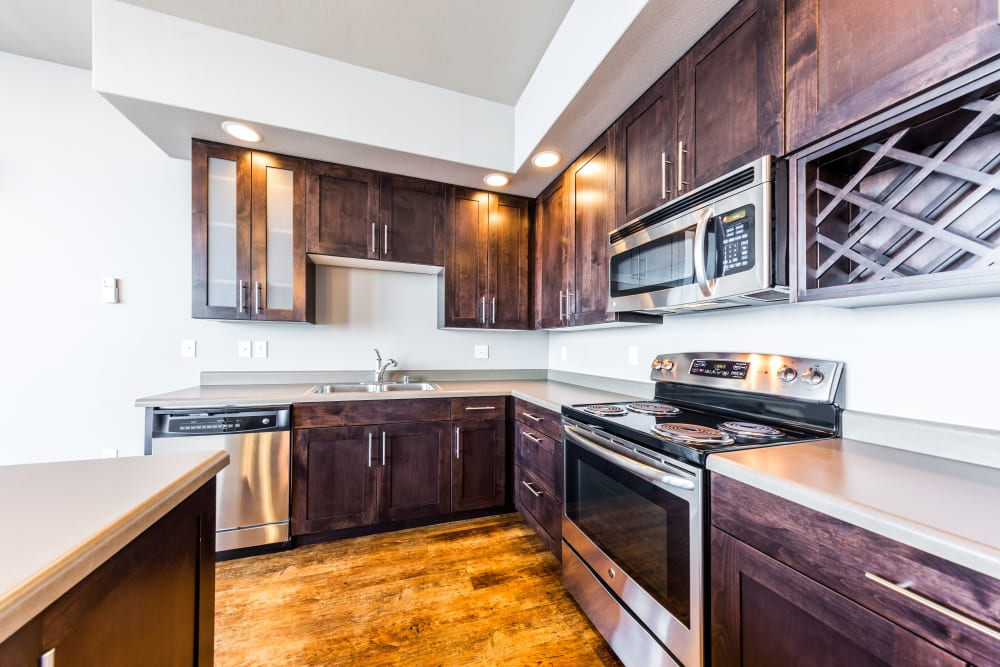 Kitchen with wood style flooring at Copperline at Point Ruston in Tacoma, Washington