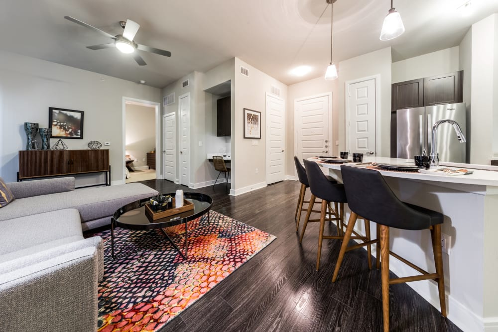 Living room with a ceiling fan at Marq 31 in Houston, Texas