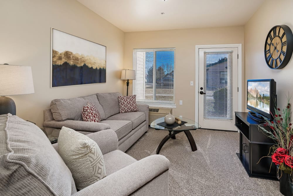 Luxurious yet comfy living room in senior living apartment at The Springs at Grand Park in Billings, Montana