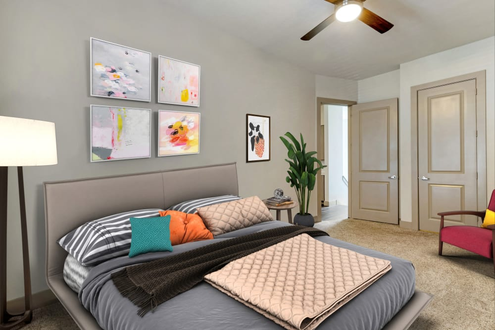 Beautifully furnished bedroom in a model apartment at The Guthrie in Austin, Texas