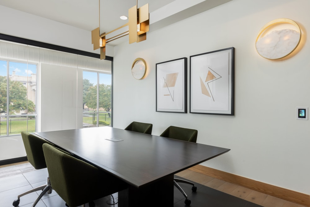 Open scenic view from a wood table with comfortable seating at 4600 Ross in Dallas, Texas