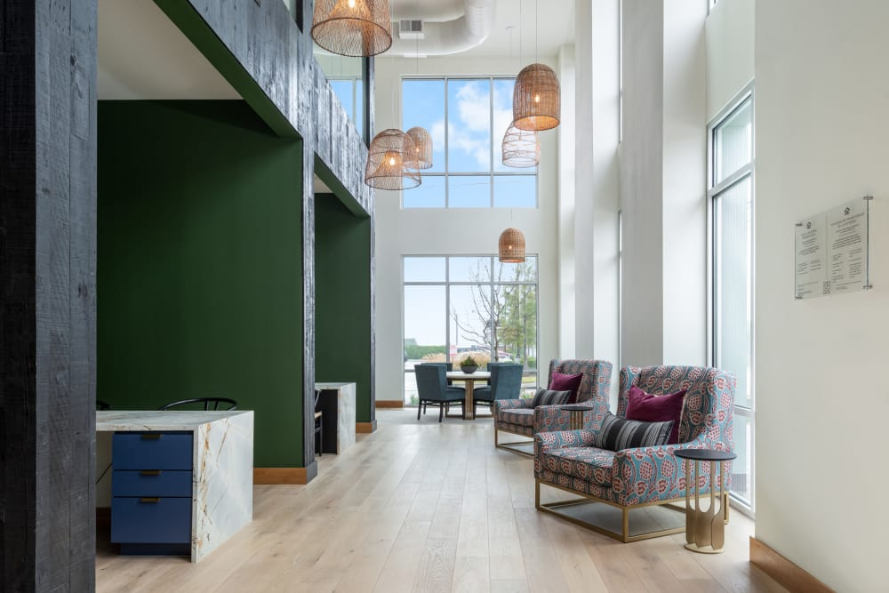 Tall plush comfortable seating area with natural lighting at 4600 Ross in Dallas, Texas