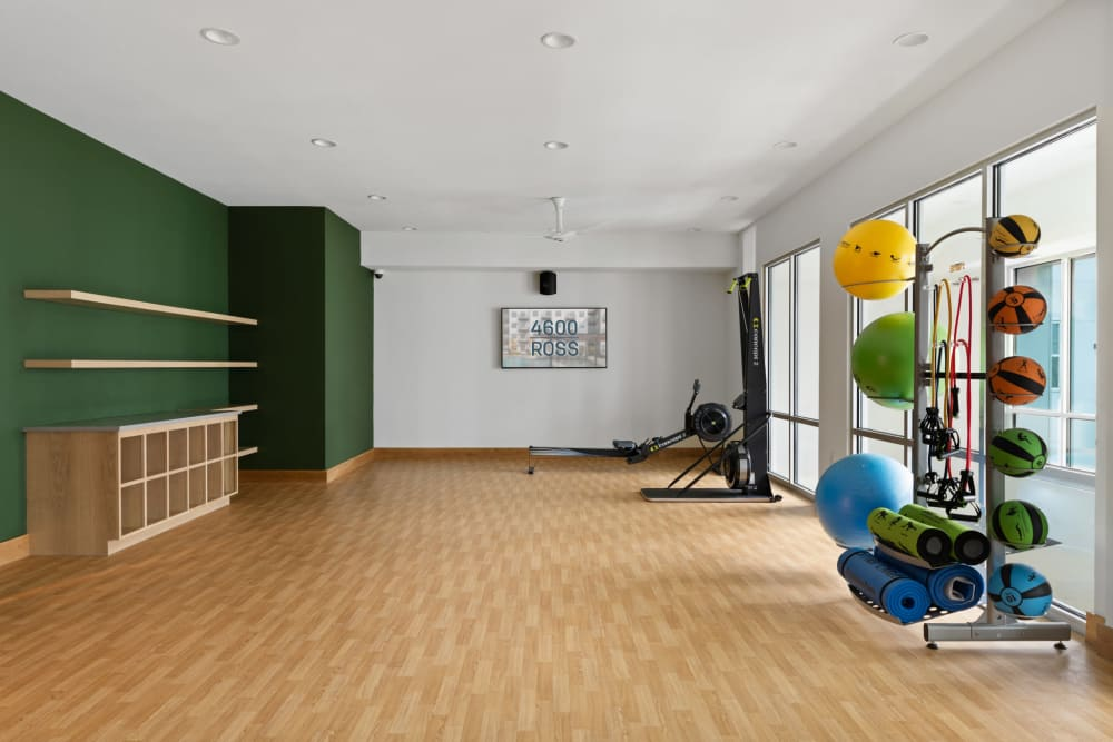 Calming yoga room with large window at 4600 Ross in Dallas, Texas