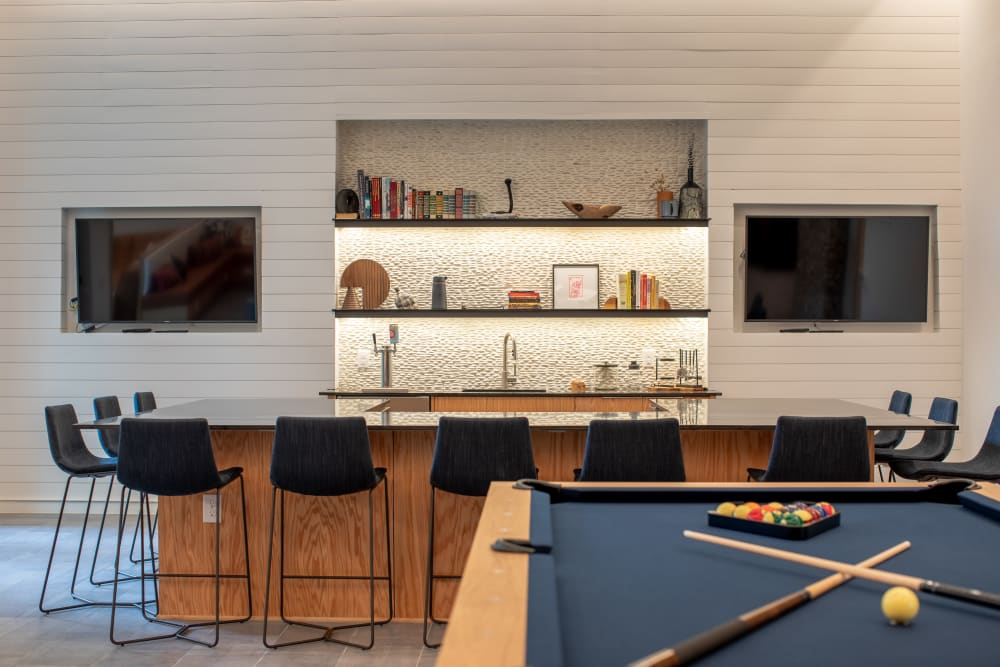 Billiard table and bar with two TVs at  in San Antonio,TX