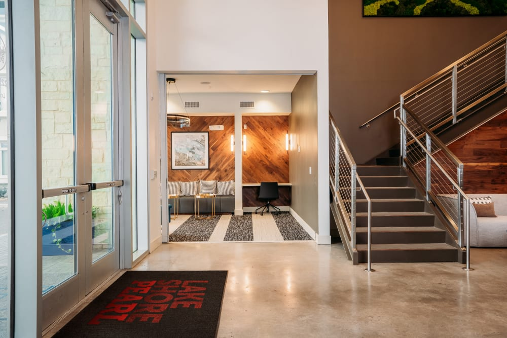 Entrance and welcome area with wood wall accents at Lakeshore Pearl in Austin, Texas