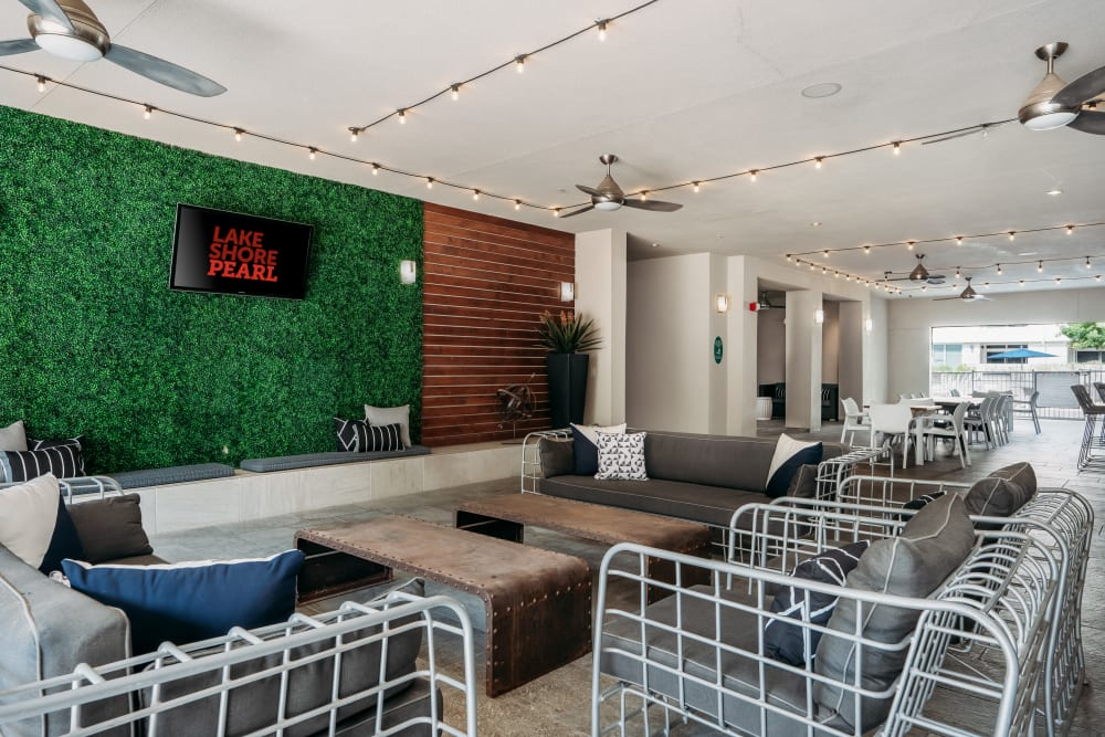 Lounge area with industrial designed tables and chairs at Lakeshore Pearl in Austin, Texas