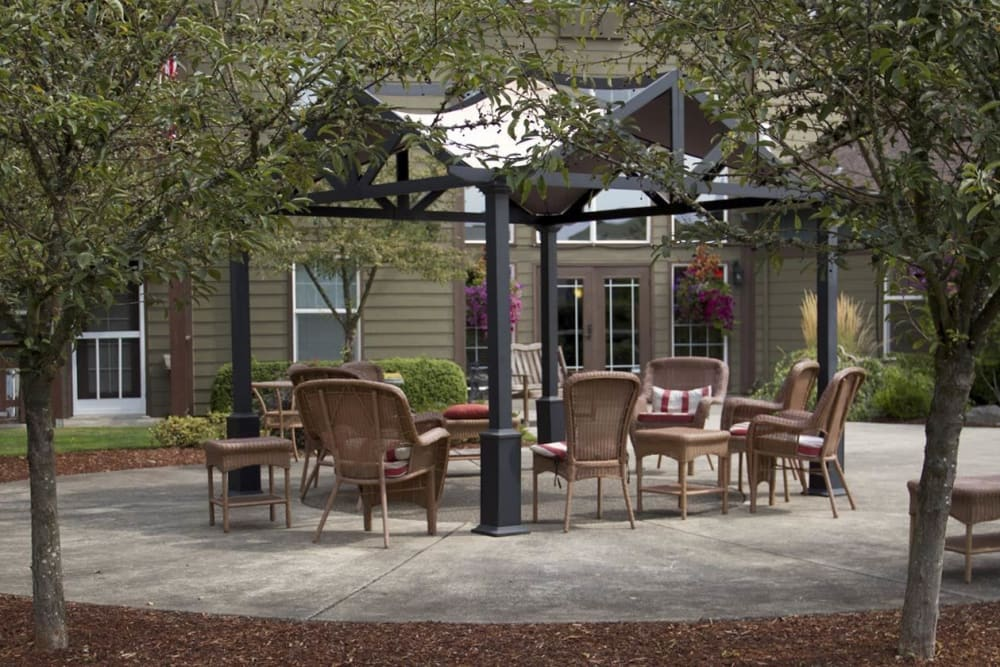 Patio area complete with chairs and table in upscale senior living facility at The Springs at Sunnyview in Salem, Oregon