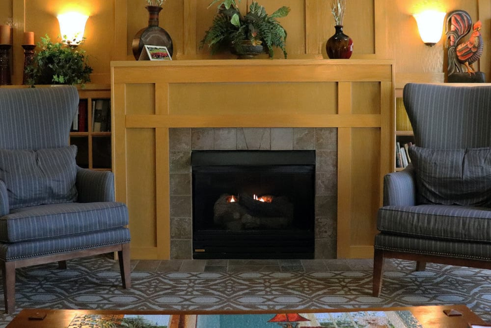 Upscale puzzle room complete with armchair seating and a fireplace at The Springs at Sunnyview in Salem, Oregon