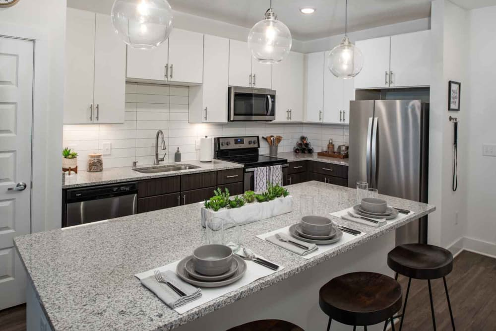 Model kitchen with island at The Jaxon in Jacksonville, Florida