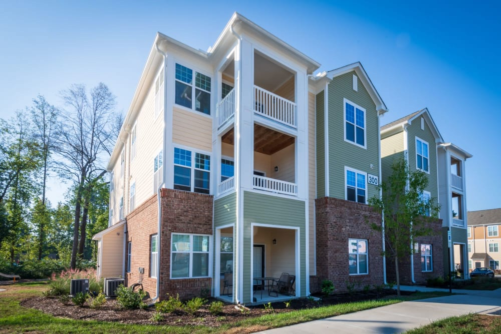 Outside view of the 3 story complex looking great at The Reserve at White Oak in Garner, North Carolina