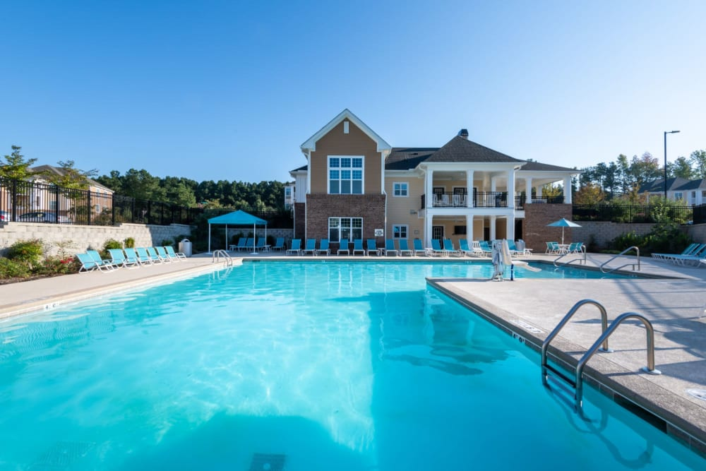 Massive resort style pool surrounded by lounge chairs at The Reserve at White Oak in Garner, North Carolina