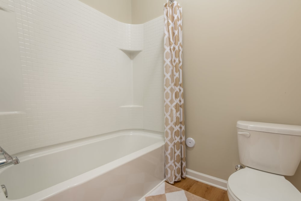 Bath and shower combo in one of the bathrooms at The Reserve at White Oak in Garner, North Carolina