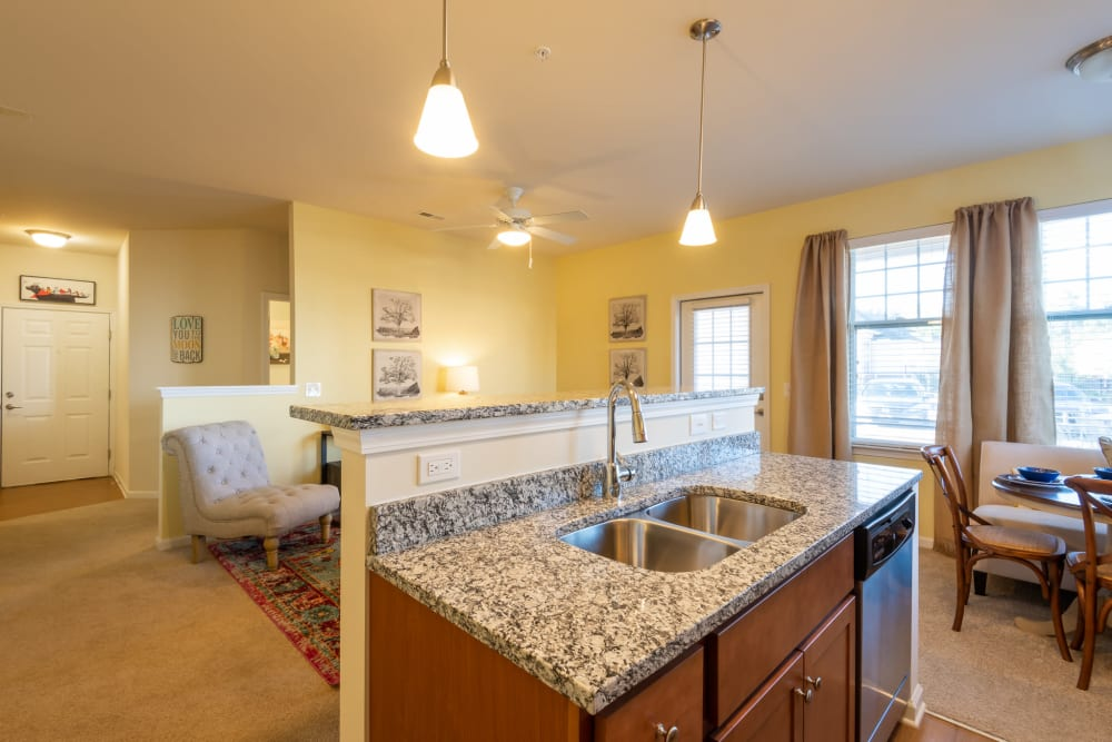 View from the kitchen across the countertop bar area at The Reserve at White Oak in Garner, North Carolina