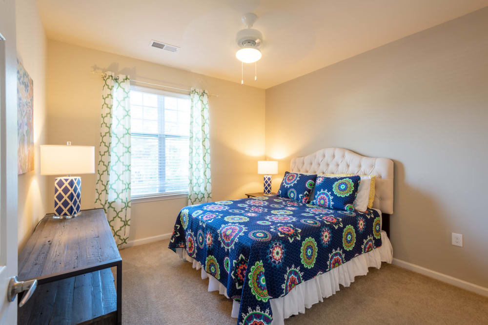 Spacious bedroom with large windows and tons of light at The Reserve at White Oak in Garner, North Carolina