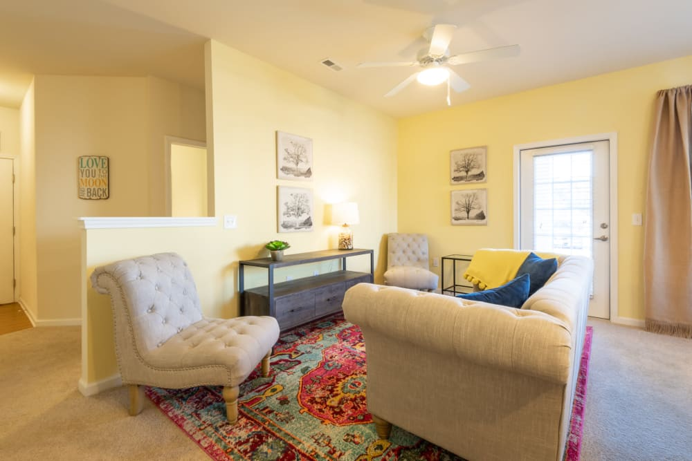 Living room area with nice area rug at The Reserve at White Oak in Garner, North Carolina