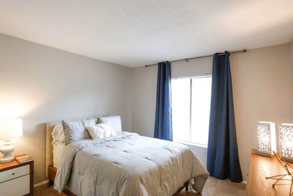 Large bedroom with tons of light at The Flats at Arrowood in Charlotte, North Carolina