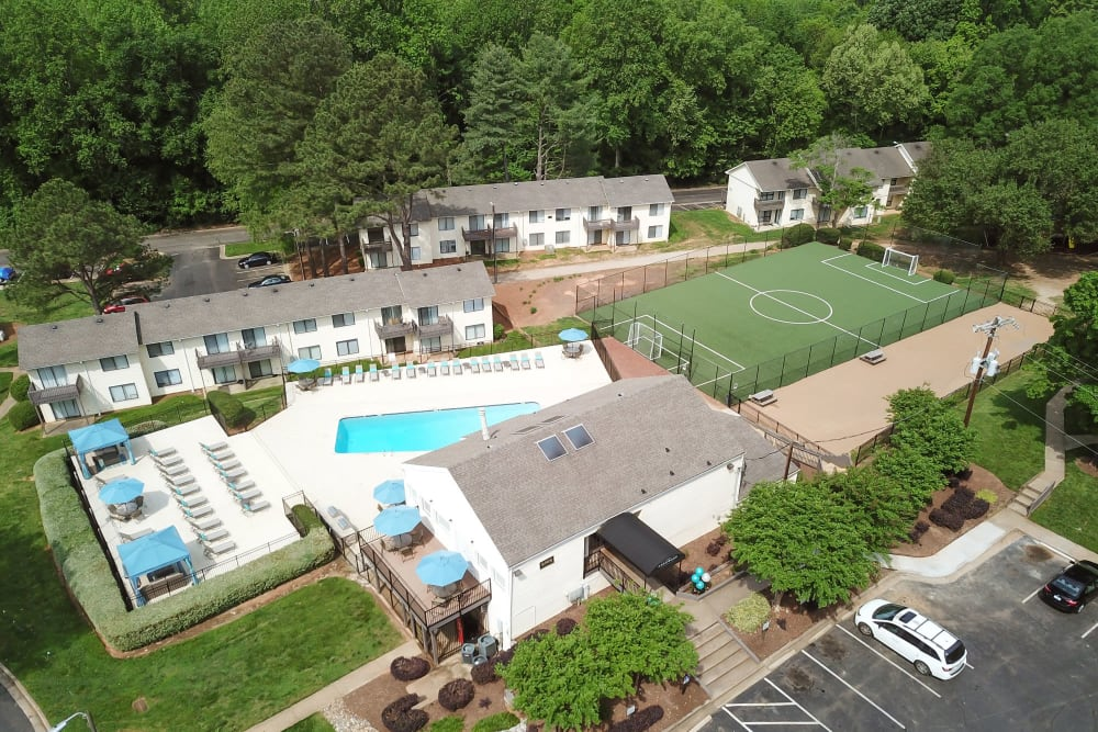 View of all the amazing amenities including the pool and soccer field at The Flats at Arrowood in Charlotte, North Carolina