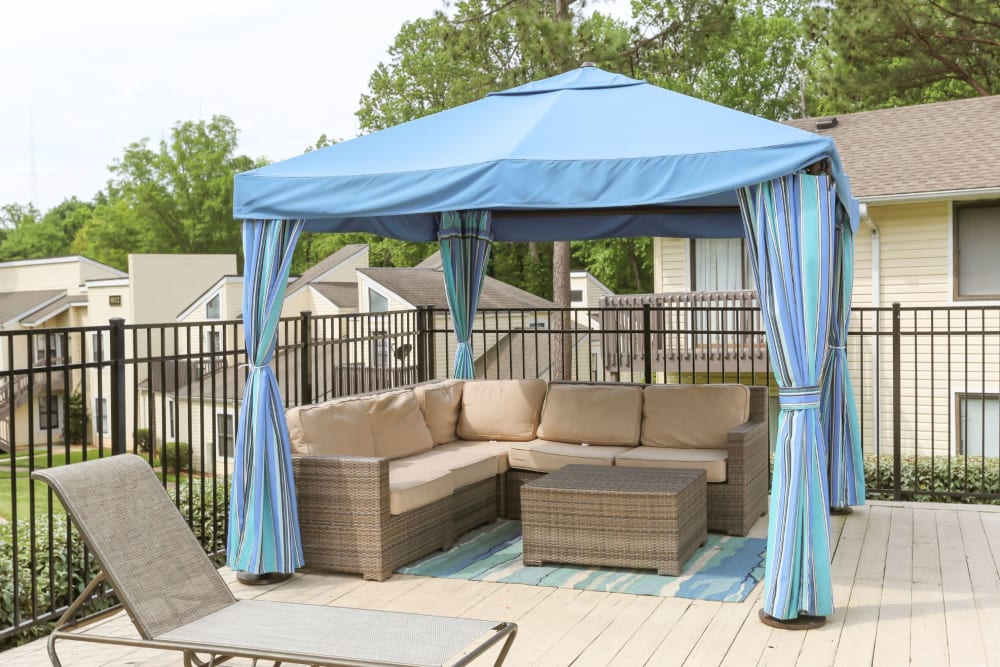 Cabana area next to the pool with outdoor couches to relax on at The Flats at Arrowood in Charlotte, North Carolina