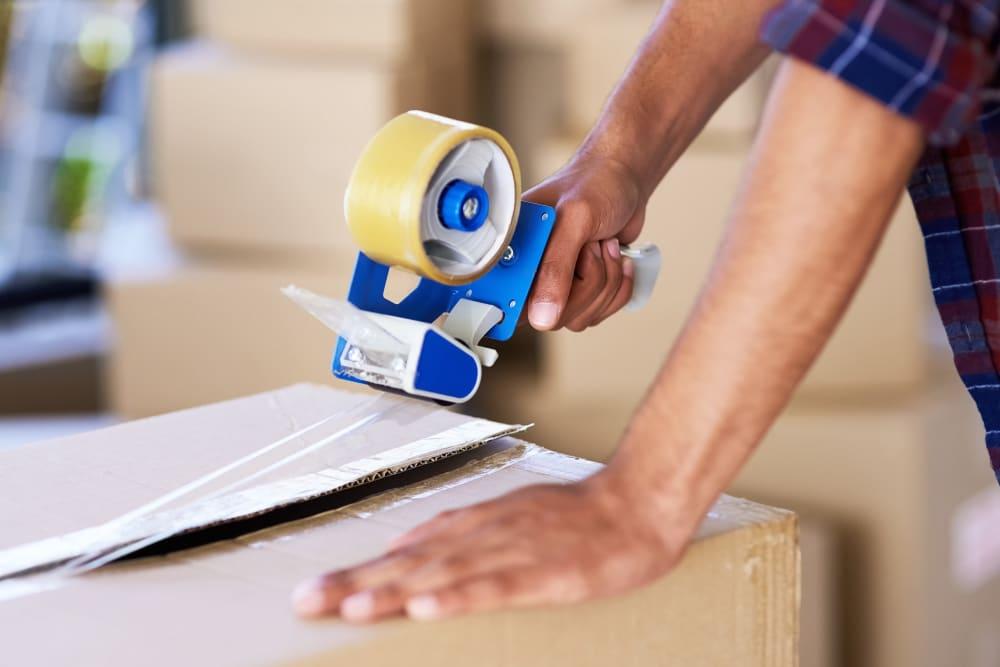 Sealing packed boxes for storage at 603 Storage - Nashua in Nashua, New Hampshire